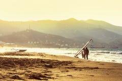 Windsurfers in the sea on Crete on sunset. Windsurfing in Heraklion. Greece.  royalty free stock photography