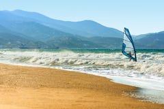 Windsurfers in the sea on Crete on sunset. Windsurfing in Heraklion. Sport concept stock photo