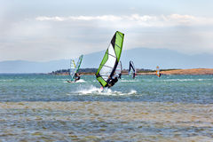 Windsurfers in the sea on daytime sky background Stock Photo