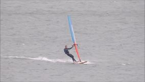 Windsurfers in training. Video footage of windsurfers windsurfing on the coast of whitstable in kent england during october 2017 stock footage