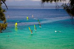 Windsurfers on water of Bol gulf Brac island, Adriatic sea, Croatia stock photography
