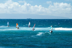 Windsurfers in windy weather on Maui Island Royalty Free Stock Photos