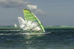 Windsurfers in windy weathers Stock Photo