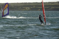 Windsurfing on al lake in Zeeland Netherlands stock photos