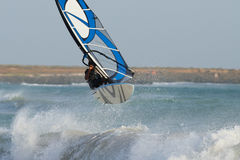 Windsurfing in big waves. Windsurfer surfing in big waves Royalty Free Stock Images