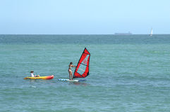 Windsurfing and boating Royalty Free Stock Photos