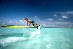 Windsurfing on Bonaire 2. Pro windsurfer performing tricks, Bonaire, Dutch Antilles, Caribbean islands royalty free stock photography