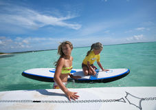 Windsurfing on Bonaire 2. Girl and surfing instructor during windsurfing lesson, Dutch Antilles, Caribbean islands Royalty Free Stock Photo