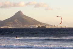 Windsurfing in Cape Town. View of table mountain from Dolphin Beach with windsurfer having fun Royalty Free Stock Photos
