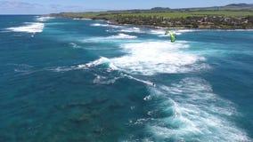 Windsurfing in huge white foamy waves in calm deep blue turquoise tropical ocean water, amazing 4k aerial drone seascape. Windsurfing in huge white foamy waves stock video footage