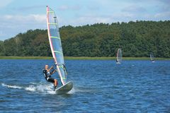 Windsurfing on the lake Nieslysz, Poland Royalty Free Stock Images