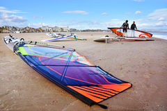 Windsurfing, Malvarrosa Beach, Valencia, Spain. Windsurfing  board and windsurfers on sunny Malvarrosa Beach, Valencia, Spain Royalty Free Stock Photo