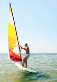Windsurfing man in sea lagoon Royalty Free Stock Image