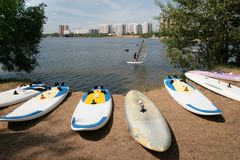 Windsurfing on the Moscow river. Boards Windsurfing on the Moscow river dry after training athletes Royalty Free Stock Image