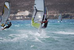 Windsurfing  on the move Stock Images