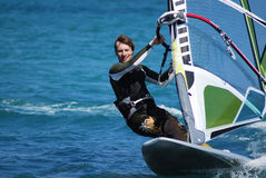 Windsurfing  on the move Stock Photos