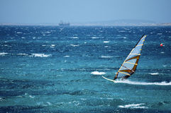 Windsurfing in the Open Sea. Fast Windsurfer in the Open Sea, Greece Stock Photography