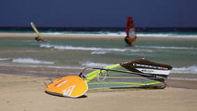 Windsurfing on Risco del Paso beach, Fuerteventura, Canary islands. Windsurfing board left on Risco del Paso beach, Fuerteventura island, Spain. Favorable windy Stock Images