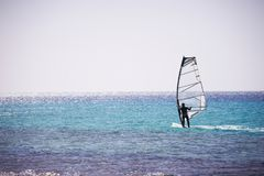 Windsurfing sail on the blue sea Stock Photo