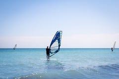 Windsurfing sails on the blue sea Stock Photo