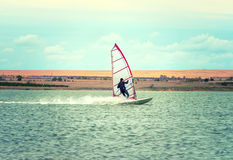 Windsurfing Sport sailing water active leisure Windsurfer on lake summer day royalty free stock photography