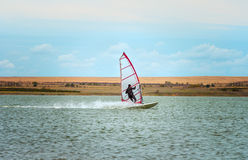 Windsurfing Sport sailing water active leisure Stock Image