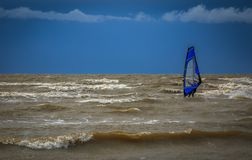 Windsurfing after storm on the Baltic Sea. A man windsurfing on the Baltic Sea directly after a storm stock image