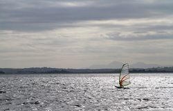 Windsurfing on Strangford Lough. 1. Windsurfing on Strangford Lough, with outline of Mourne Mountains in background. Northern Ireland Royalty Free Stock Photography