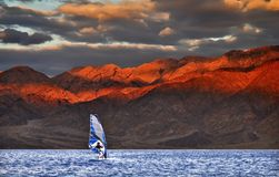 Windsurfing at the gulf of Eilat. This shot was taken near Eilat city - one of the famous tourist spot and resort city in Israel Stock Images