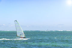 Windsurfing. Windsurfer Surfing The Wind On Waves In Ocean, Sea. Extreme Sport Action. Recreational Sporting Activity. Healthy royalty free stock images