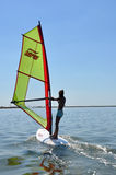 Windsurfing women. A woman is windsurfing  in the lake Stock Photography