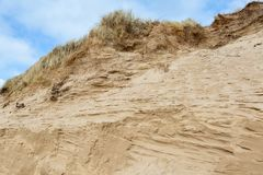 Windswept sand dunes at Newborough beach in Anglesey stock image