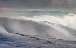 Windswept snowy ridges of Krizna peak Velka Fatra Slovakia stock photos
