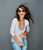 Windswept woman scrunching shirt Royalty Free Stock Photography