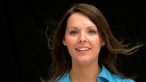 Windswept woman smiling Stock Photo