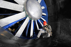 Windtunnel mainenance worker Stock Photo