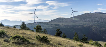 Windturbine against blue sky. With white clouds Royalty Free Stock Photo