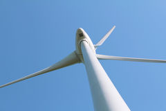 Windturbine against clear blue sky Stock Photo