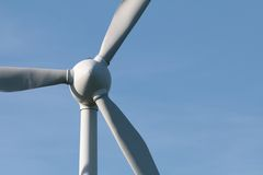 Windturbine and beautiful clear blue sky Royalty Free Stock Photo