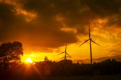 Windturbine during beautiful sunset Stock Image