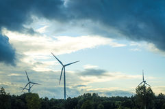 Windturbine during beautiful sunset Stock Photo
