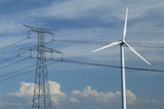 A windturbine close to a electric pylon Royalty Free Stock Images