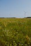 Windturbine at sunny day Stock Photo