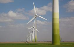 Windturbines on a agricultural field Stock Images