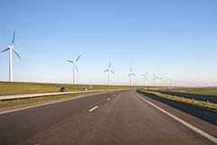 Windturbines along a countryroad Stock Image