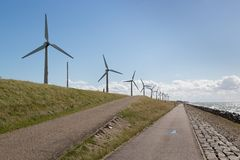 Windturbines along a Dutch dike near Urk Stock Photography