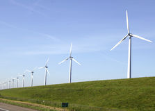 Windturbines on a dike Stock Photography