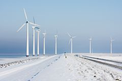 Windturbines in a Dutch winter landscape Stock Images