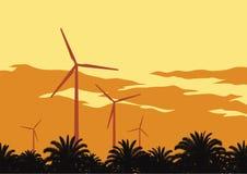 Windturbines en oranje hemel Stock Afbeelding