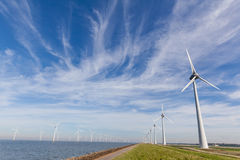 Windturbines at the IJsselmeer in the Netherlands. View of windpark in the Dutch Noordoostpolder, Flevoland. Near the city of Urk. On and offshore windturbines Royalty Free Stock Images